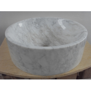 white polsihed round marble sinks